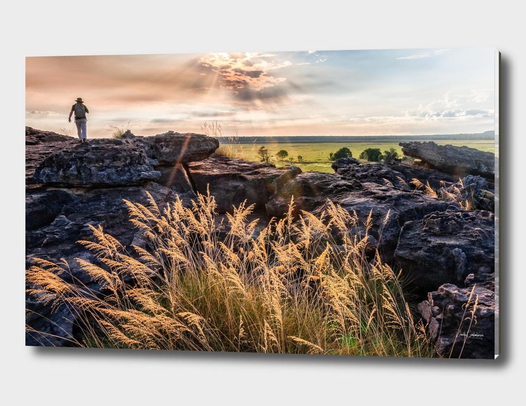 A person exploring Ubirr Rock, Australia