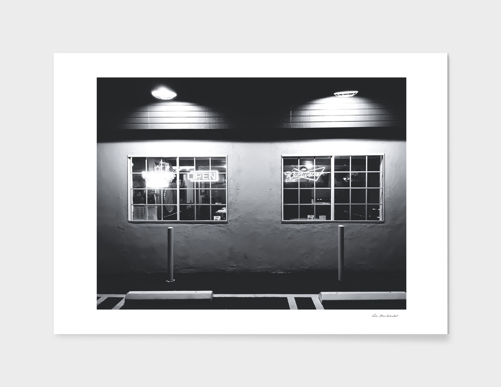 windows of the bar and restaurant in black and white