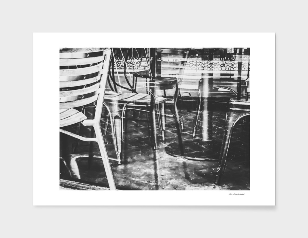 outdoor chairs in the city in black and white