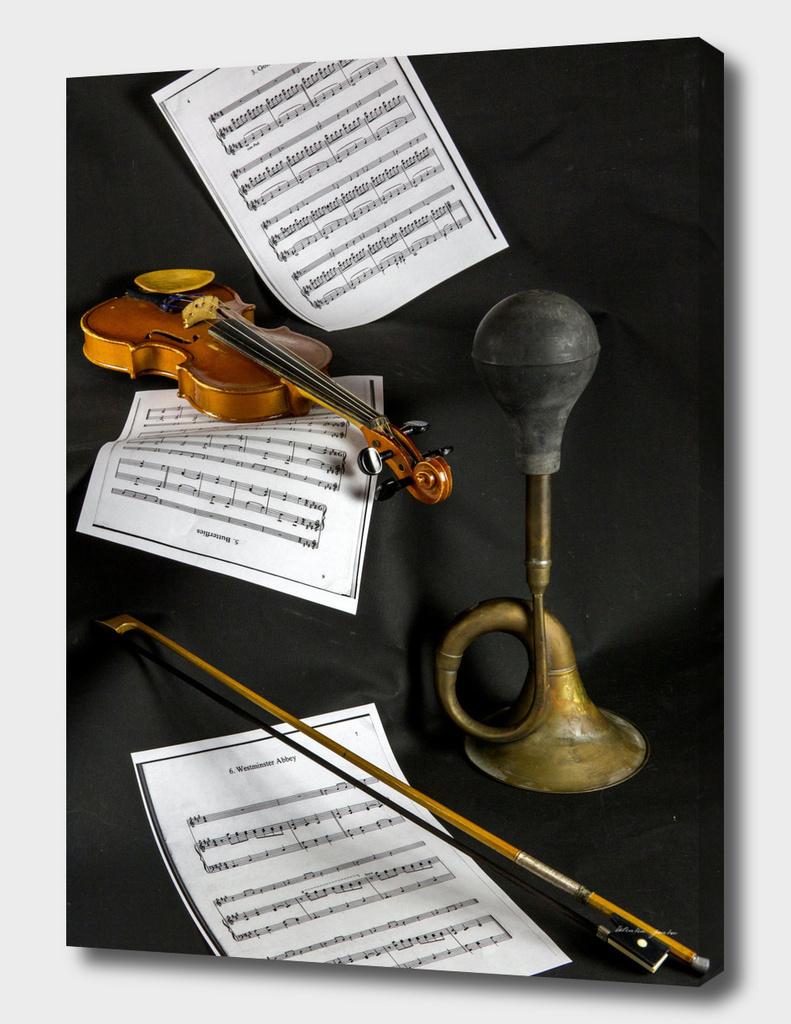 Violin, sheet music and trumpet