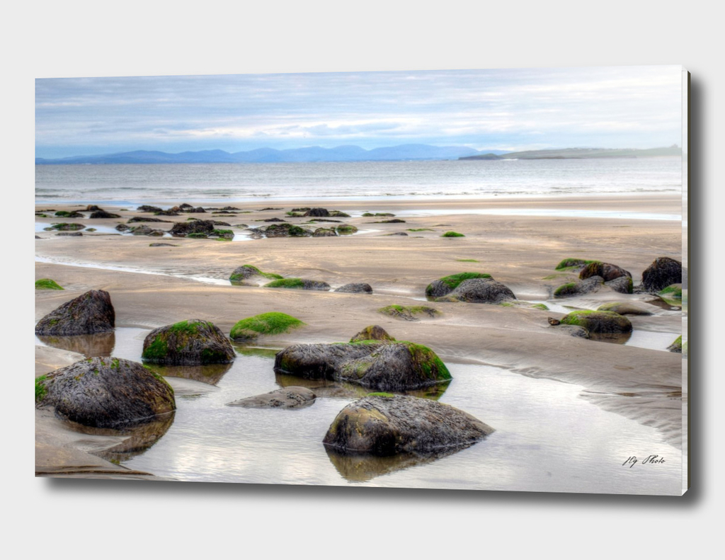 Relaxing beach with stones at sunset. Seascape