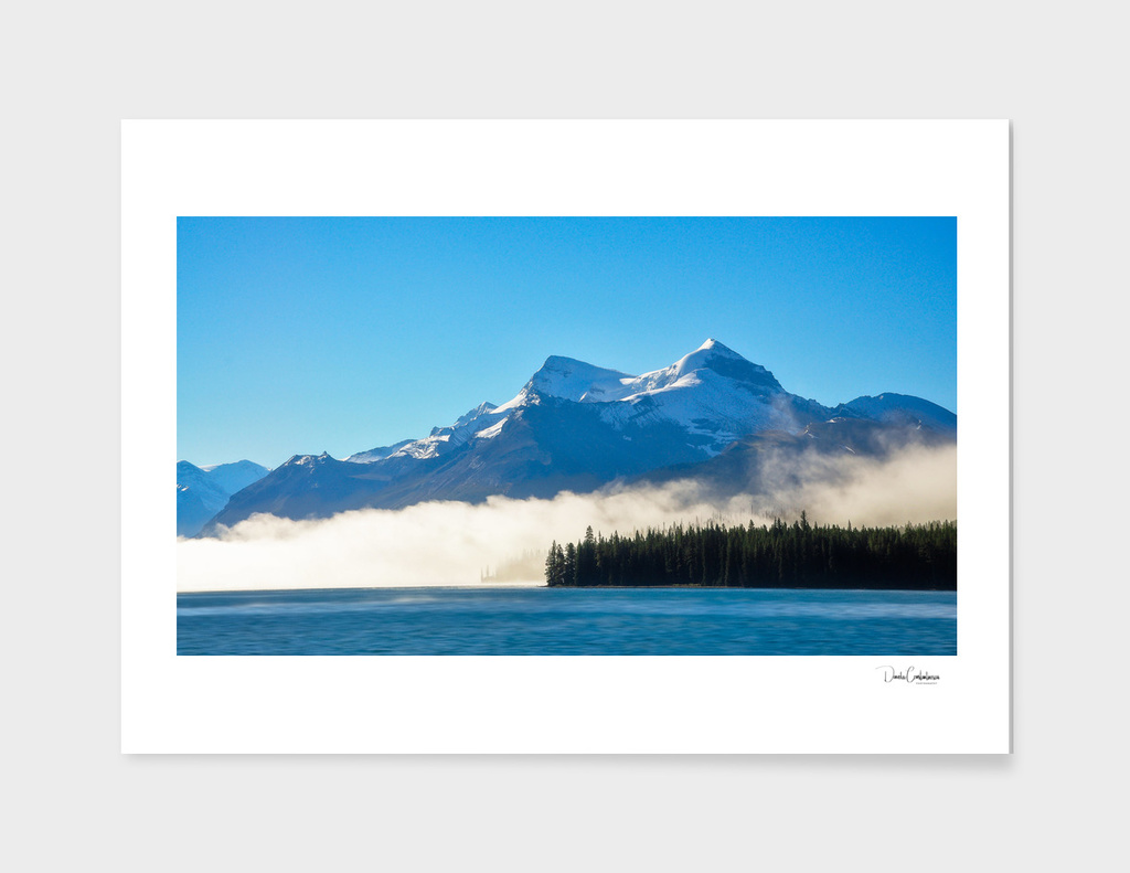 Morning fog at lake Maligne