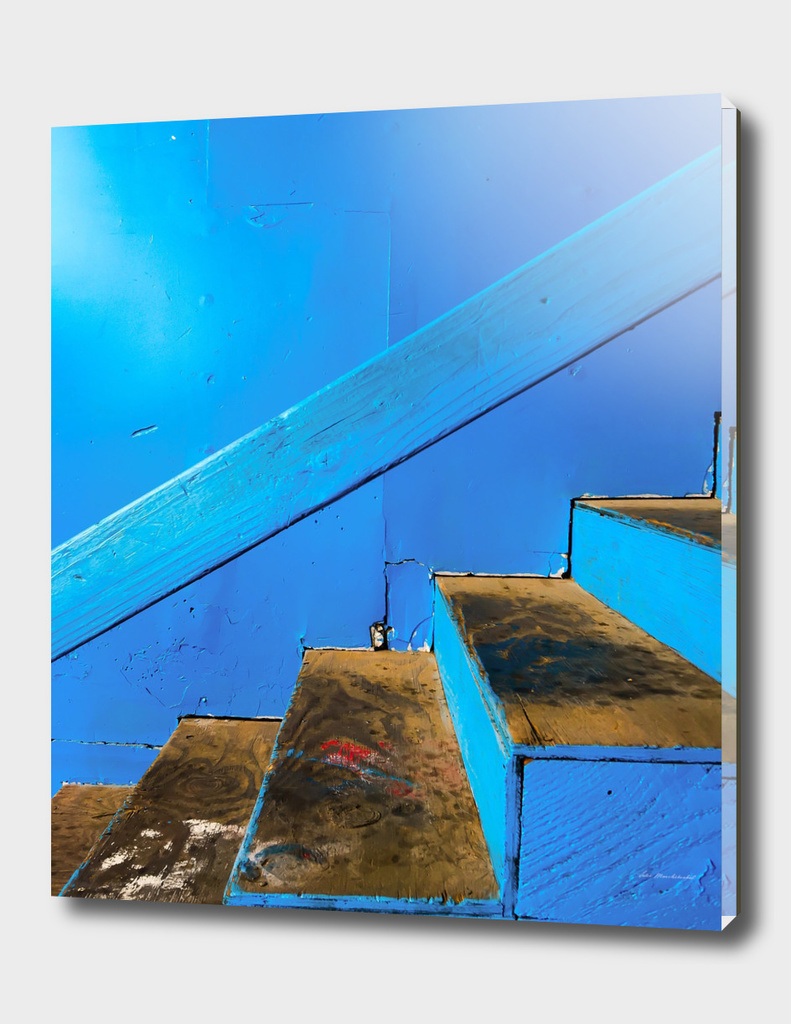 blue and brown old wood stairs with blue wall background