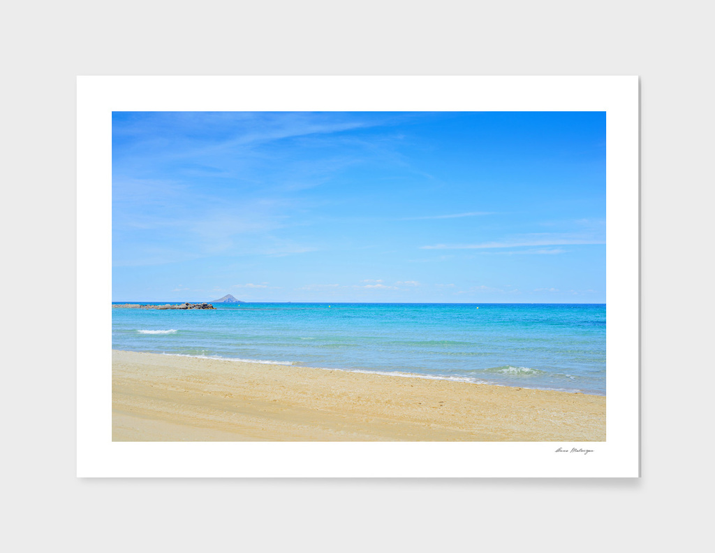 Sandy beach and blue Mediterranean sea