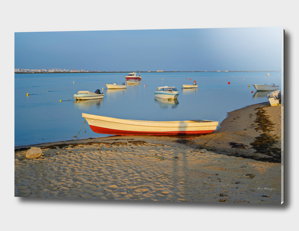 Photo of boats in bay at sunset in Portugal