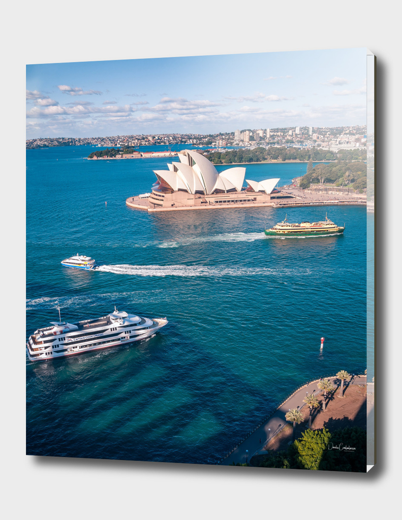 White pearl of Opera House in blue waters of Sydney Harbour