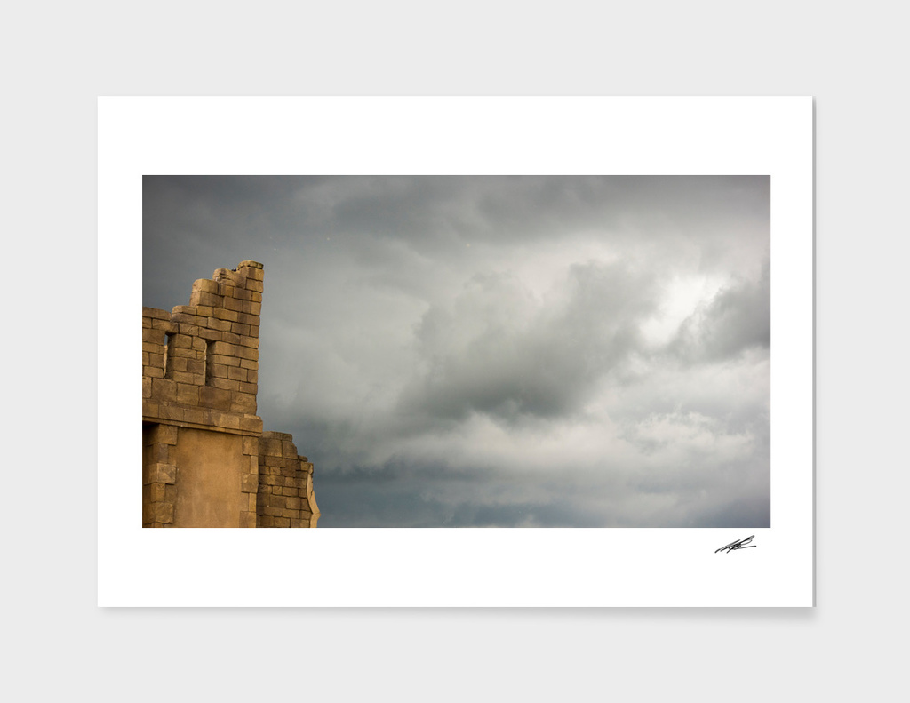 Dark clouds over ruin