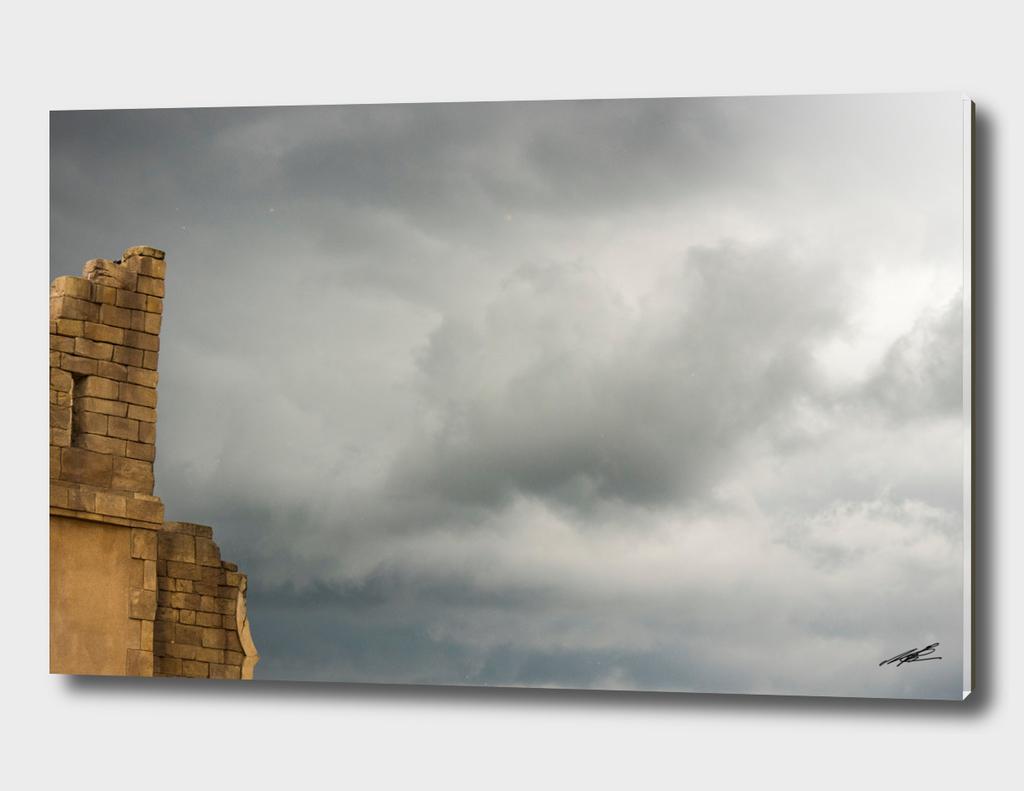 Dark clouds over ruin