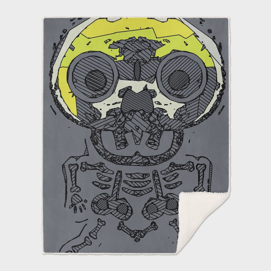yellow skull and bone graffiti drawing with grey background