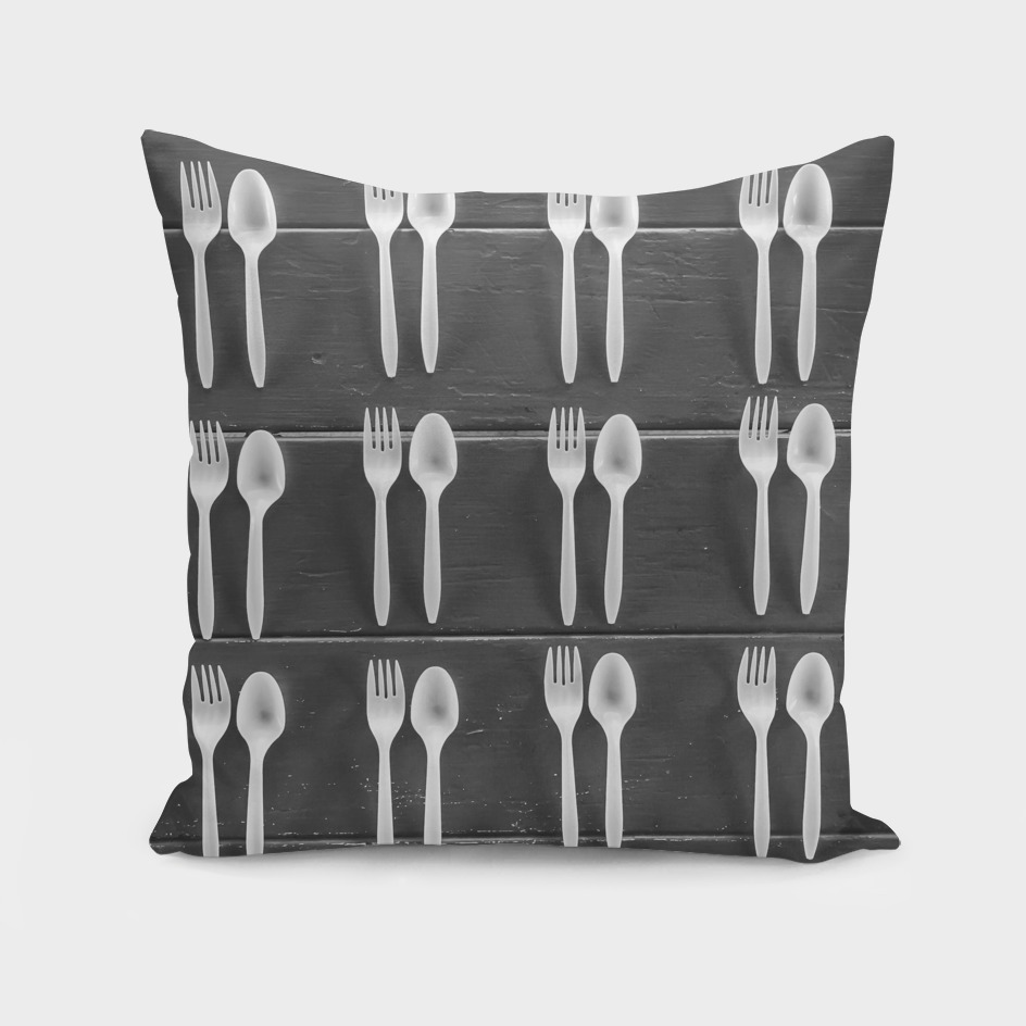 fork and spoon with wood background