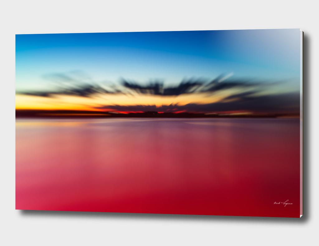 Dramatic smooth ocean sunset