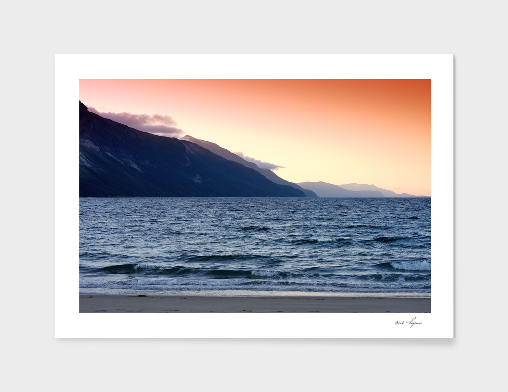 Evening at northern mountain beach