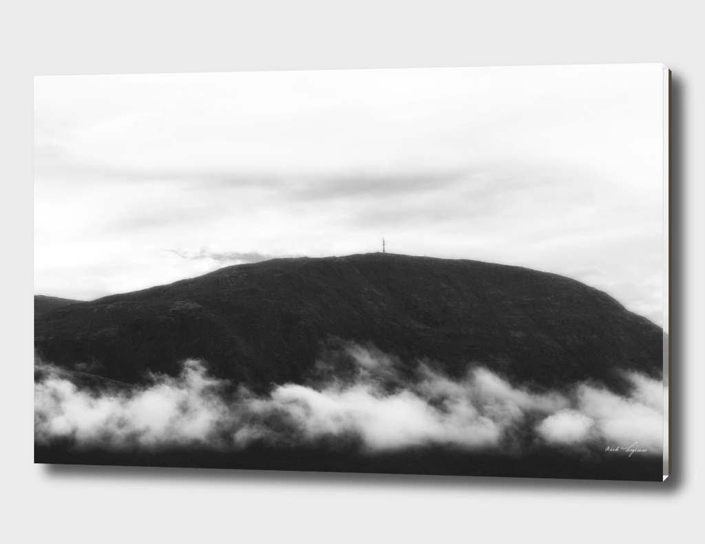Dramatic mountain hill in clouds