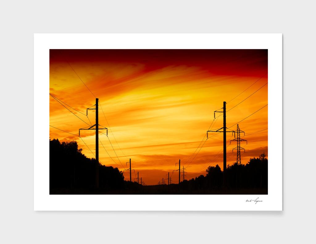 Dramatic sunset near power lines